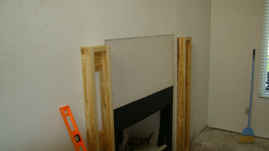 Feature wall getting a fireplace and mantle