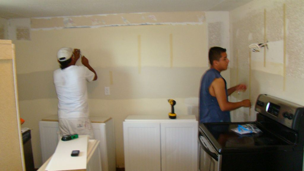 Prepping walls prior to hanging cabinets